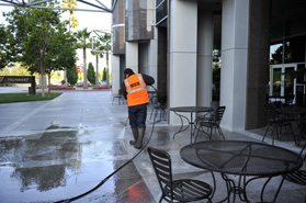 pressure washing the ground at an office complex in Milpitas, CA