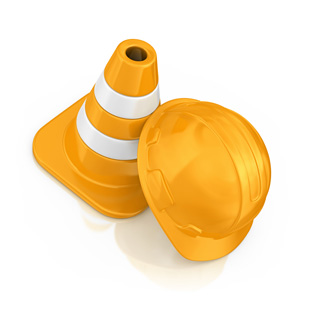 construction cone and hard hat used during routine property maintenance