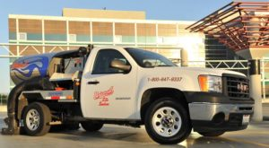 Vacaville parking lot sweeping service truck by Universal Site Services.