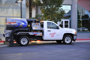 Universal site services truck doing parking lot sweeping