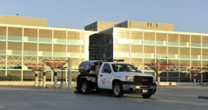 USS truck in from of commercial building doing parking lot sweeping in Napa, CA