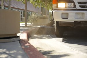 Sweeping the parking lot curb